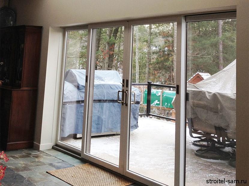 Пластиковые окна в виде дверей